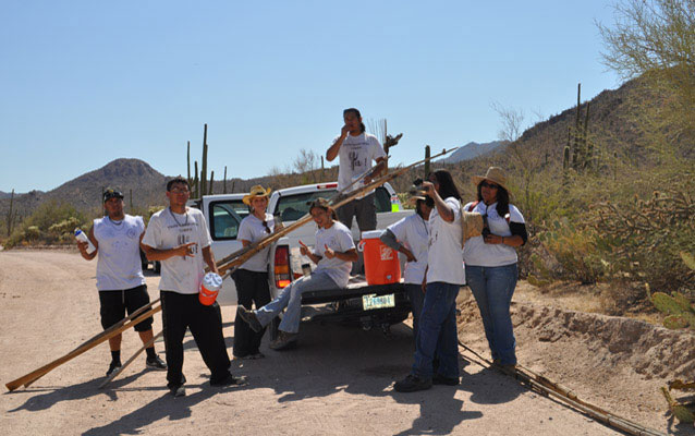 Youth Conservation Corps members relax at the pickup truck after a day of harvesting saguaro fruits