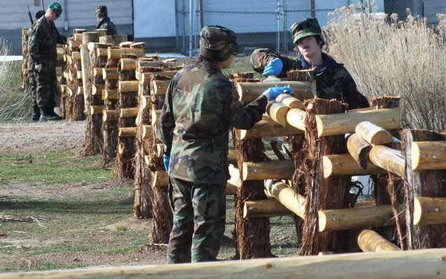 Cadets Applying Linseed Oil to Fence
