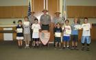 Campers receive their Junior Ranger Badge and Certificate from Park Rangers