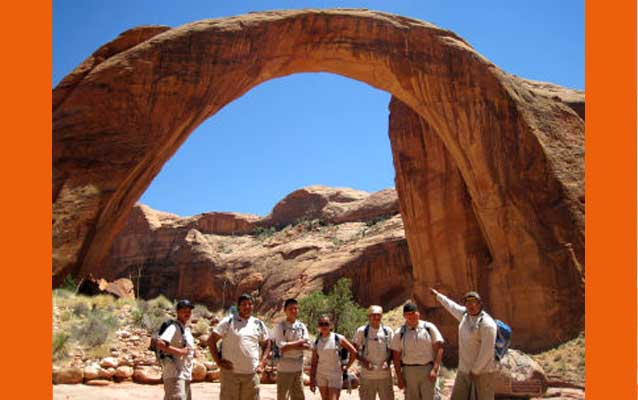 Native Conservation Corps participants in front of  Rainbow Bridge natural arch