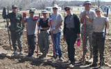 Cadets standing with tools in the Heritage Garden