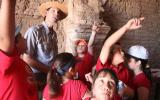 ranger and students pointing at inside of adobe church