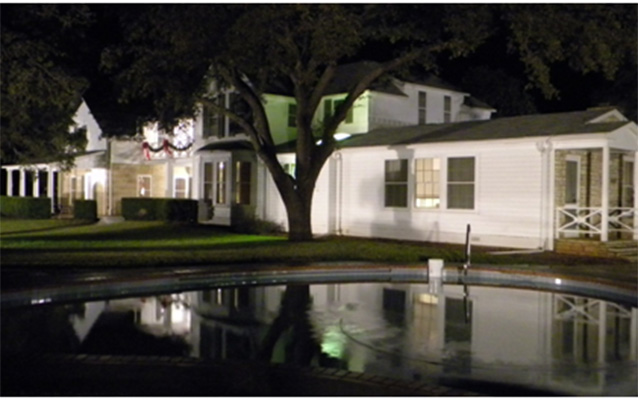 The Texas White House at night