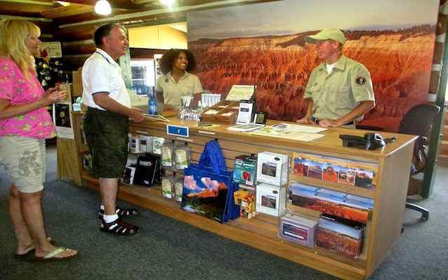 An IIC Intern answers visitor questions at the Cedar Breaks National Monument Visitor Center