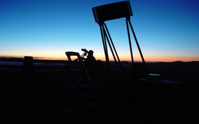 An astronomy volunteer calibrates equipment at Cedar Breaks National Monument