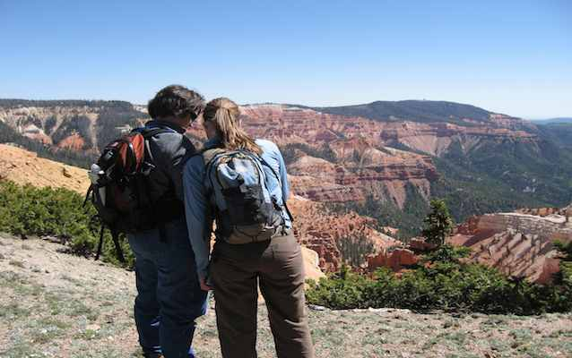 Visitors admire the view of Cedar Breaks' geologic amphitheater