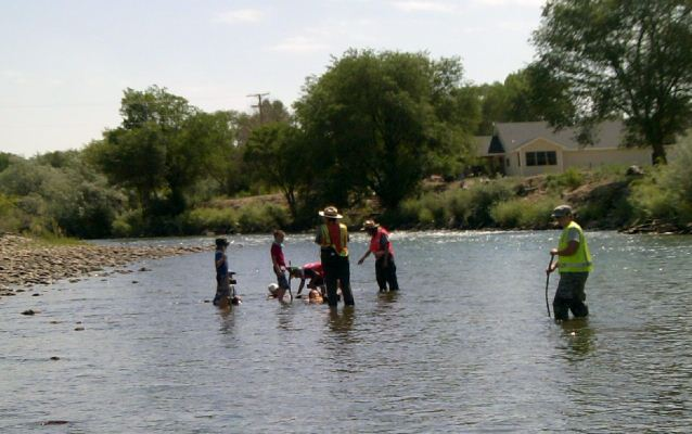 Children in river at approximate location of new pedestrian bridge