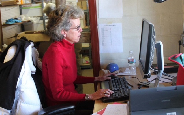 Volunteer uploading photos to the Digital Archaeological Record (tDAR)