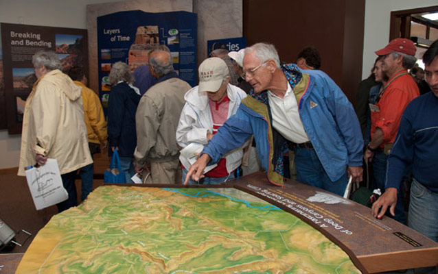 Visitors enjoying the new exhibits in Saddlehorn Visitor Center.