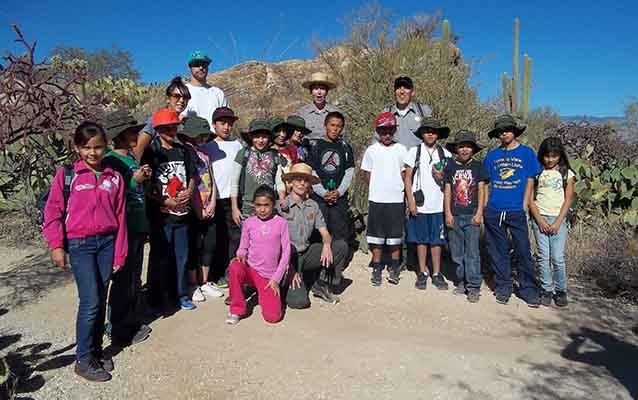 Children's Hiking Club student hikers with leaders in Saguaro National Park
