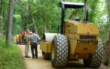 Park staff and trail grader on towpath.