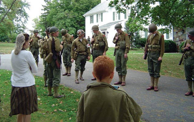 A row of World War II living history participants