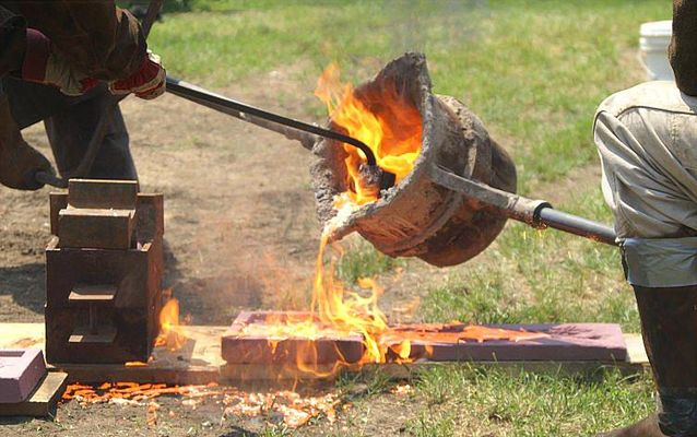 An outdoor Iron Pour underway at Saugus Iron Works National Historic Site