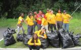 Lowell Spindle City Corp with bags of waste material from a recent clean-up.