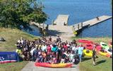 Mount Washington Middle School Students gather to celebrate a successful day on the water in Baltimore.