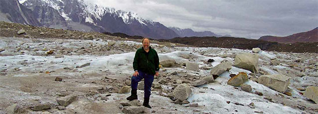 Bob Winfree stands in a field of rubble and ice