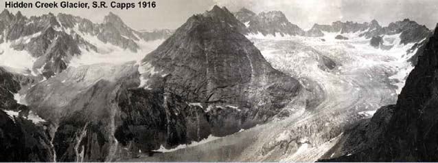black and white image of a large glacier curling around a spire of mountain