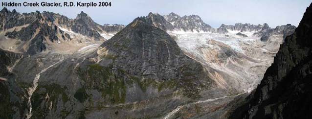 image of a small glacier near a rocky mountain