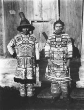 photograph of two Alaska Native men wearing traditional clothing