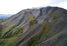 steep scree slope of a dark mountain