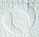 white quilt patch with raised hoof pattern