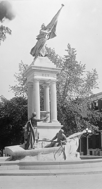 Stone monument with Liberty atop with flag with the name Key carved in the stone