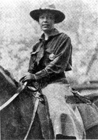black and white image of a woman on horseback