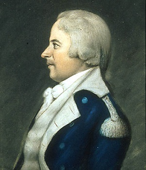 profile portrait of white haired man in blue with white trim military uniform