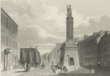Battle of Baltimore monument with street scene around