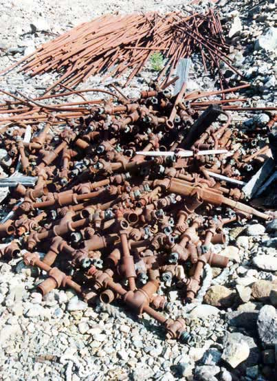 pile of rusted metal pipes and metal rods