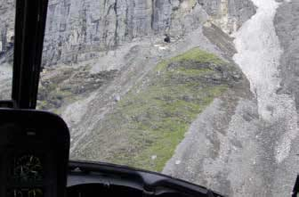 aerial view of small openings in a mountainside