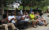Members of the community play Berimbaus (African string instrument made of a gourde and bow) near the drum circle in Meridian Hill Park.
