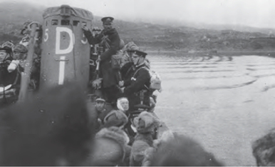 Japanese soldiers stand on submarine.