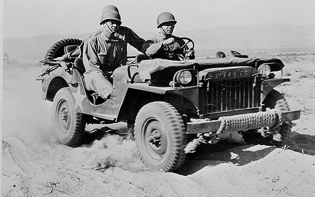 Indio, California. A half-ton jeep rolling over the desert at the desert training center June 1942