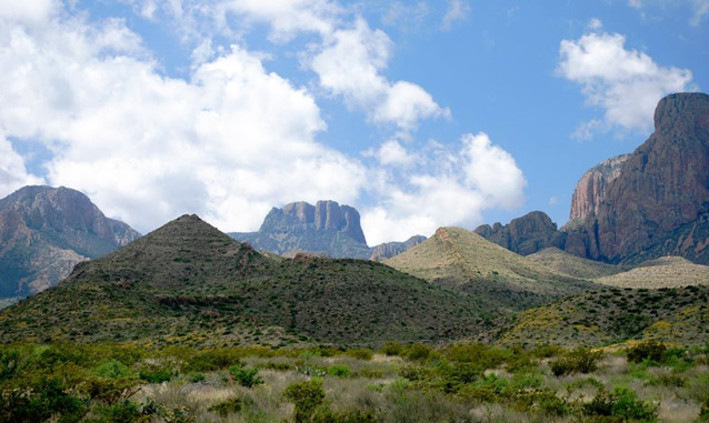 Peaks and rugged terrain against a partly cloudy sky at Big Bend National Park