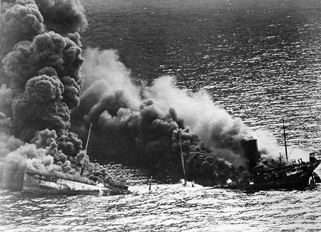 Dixie Arrow, a tanker, burns off the coast of the Outer Banks after being torpedoed