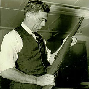 image of John Garand holding an M1 rifle stock