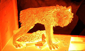 Wolf sculpture glows in firing kiln