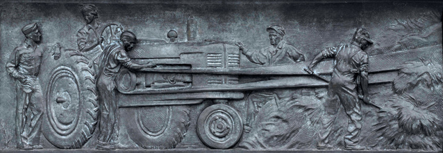 Bas relief of farmers harvesting wheat