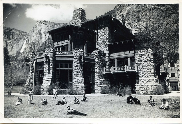 B&W photo of sailors reclining in front of ahwahnee hotel