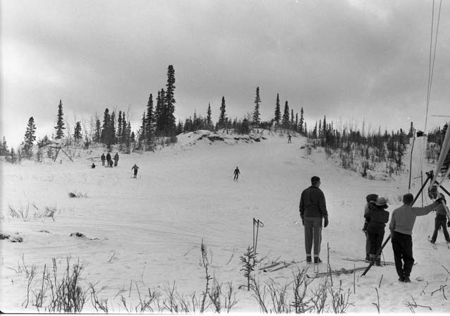 historic image of people skiing on a hill