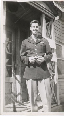 A man in uniform poses for a photo