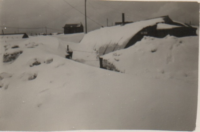 Quonset hut buried in snow
