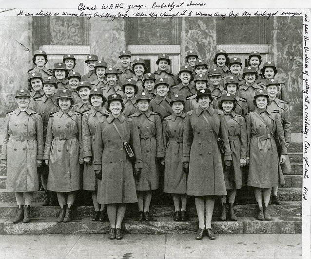 Six rows of women in uniforms pose for a picture
