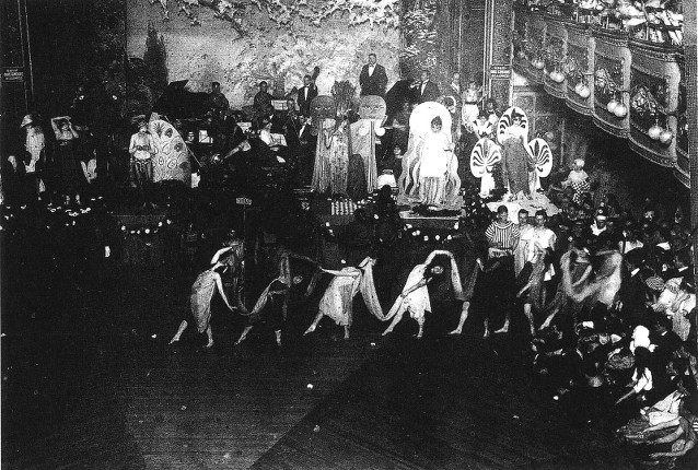 Inside the Webster dance hall in the 1920s, with an audience watching costumed performers