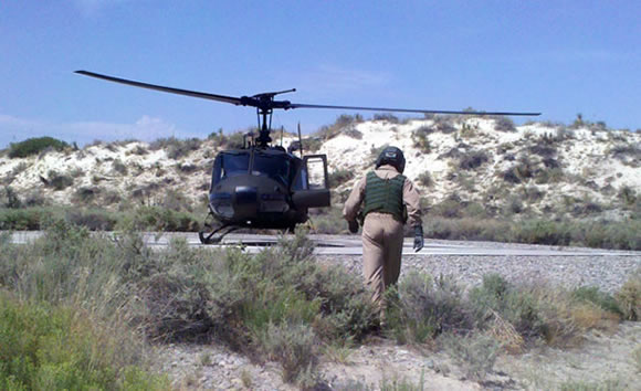Black helicopter in the desert