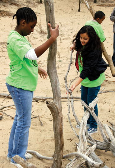 Children build with driftwood at the Nature Play Zone at Indiana Dunes National Lakeshore