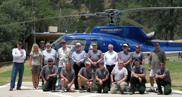 Group photo of pilots in front of a helicopter