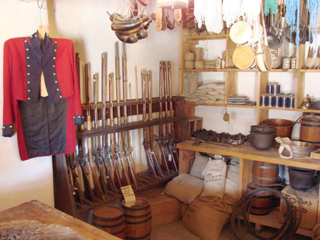 Goods such as weapons and cooking supplies at the reconstructed fort at Bent's Old Fort NHS