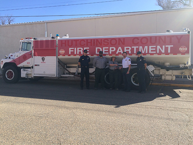 NPS and Fire Department staff with donated water tender